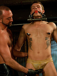 Trent Diesel and Leo Forte are kept in metal bondage and fucked during a live shoot.