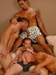 Four hot muscle studs share one bed