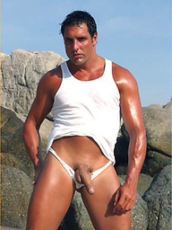 Stud Marcello at the beach wearing a white thong and playing with his cock