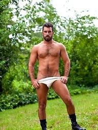 Muscle bear Damien Stone outdoors