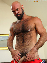 Muscled bear Marco Rios shows his uncut dick
