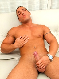 Muscle hunk John strokes his dick