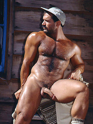Carl Hardwick demonstrates his muscled hairy chest