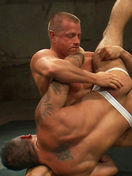 Two hot, hung studs wrestle for the right to a brutal victory fuck that will leave the loser's ass sore and in shame.