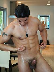 Latin muscle man plays with his rock-hard boner
