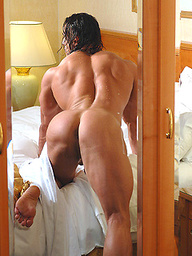 Long haired bodybuilder Lex Attila flexes his muscles and enjoys a hot shower