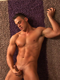 Muscle hunk Bruce jacking off dick
