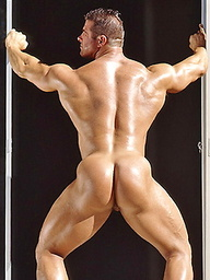 Big hairy hunk shows his perfect muscled body