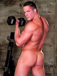 Erik Rhodes strokes his muscle cock