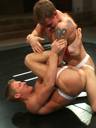 Big-dicked muscle hunks with perfectly chiseled bodies fight to dominate each another on the mat with winner fucking the loser till he begs for mercy.