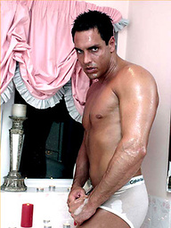 Marcello gets wet in the bath as he wanks his big cock