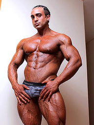 Super tan, super cool, super ripped, and super hung bodybuilder Mauro Marinello