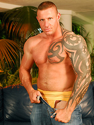 Muscled man shows his hot tattooed body