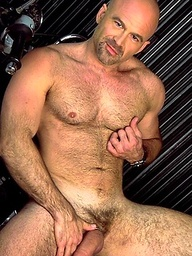 Handsome muscular man with a huge cock and beautiful chest.