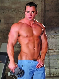 Muscle brunette Ace Hanson in a gym